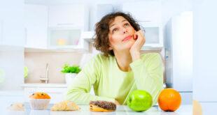 Donna che pensa alla dieta